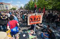 Etwa 6.000 Menschen protestierten am Samstag den 26. April 2014 gegen einen von der Neonazipartei NPD geplanten Aufmarsch durch Kreuzberg. Sie verhinderten mit verschiedenen Blockaden rund um den Auftaktort des NPD-Aufmarsches, dass die ca 70 Neonazis weiter als 150m laufen konnten.<br /> So war nach 3 Minuten Marsch für die NPD Schluss und die Neonazis mussten zum Startpunkt am S-Bahnhof Jannowitzbruecke umdrehen. Auch wenn ueber den NPD-Lautsprecherwagen mehrfach behauptet wurde, die Demonstration sei in Kreuzberg, ist doch richtig, dass die Neonazis sich nur in Berlin-Mitte befanden.<br /> 26.4.2014, Berlin<br /> Copyright: Christian-Ditsch.de<br /> [[Inhaltsveraendernde Manipulation des Fotos nur nach ausdruecklicher Genehmigung des Fotografen. Vereinbarungen ueber Abtretung von Persoenlichkeitsrechten/Model Release der abgebildeten Person/Personen liegen nicht vor. NO MODEL RELEASE! Don't publish without copyright Christian-Ditsch.de, Veroeffentlichung nur mit Fotografennennung, sowie gegen Honorar, MwSt. und Beleg. Konto:, I N G - D i B a, IBAN DE58500105175400192269, BIC INGDDEFFXXX, Kontakt: post@christian-ditsch.de<br /> Urhebervermerk wird gemaess Paragraph 13 UHG verlangt.]