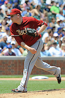 Arizona Diamondbacks starting pitcher Trevor Cahill #35 delivers a pitch during a game against the Chicago Cubs at Wrigley Field on July 15, 2012 in Chicago, Illinois. The Cubs defeated the Diamondbacks 3-1. (Tony Farlow/Four Seam Images).