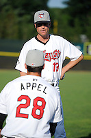 Tri-City ValleyCats starting pitcher Mark Appel #28 talks with pitching coach Doug White #13 before his first professional start against the Lowell Spinners on July 5, 2013 at Joseph L. Bruno Stadium in Troy, New York.  Appel was the first overall selection of the 2013 Major League Baseball Draft by the Houston Astros out of Stanford University.  (Mike Janes/Four Seam Images)