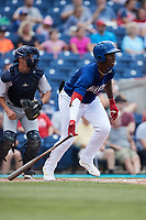 Luis Mieses (21) of the Kannapolis Cannon Ballers follows through on his swing against the Charleston RiverDogs at Atrium Health Ballpark on July 1, 2021 in Kannapolis, North Carolina. (Brian Westerholt/Four Seam Images)