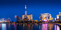 Panorama on the Paris Hotel Eiffel Tower, Ballys, Flamingo, and Planet Hollywood hotels lit up at twilight in Las Vegas, Nevada