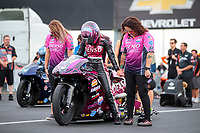 Aug 30, 2019; Clermont, IN, USA; Crew members pray with NHRA pro stock motorcycle rider Angie Smith during  the pre race prayer prior to qualifying for the US Nationals at Lucas Oil Raceway. Mandatory Credit: Mark J. Rebilas-USA TODAY Sports