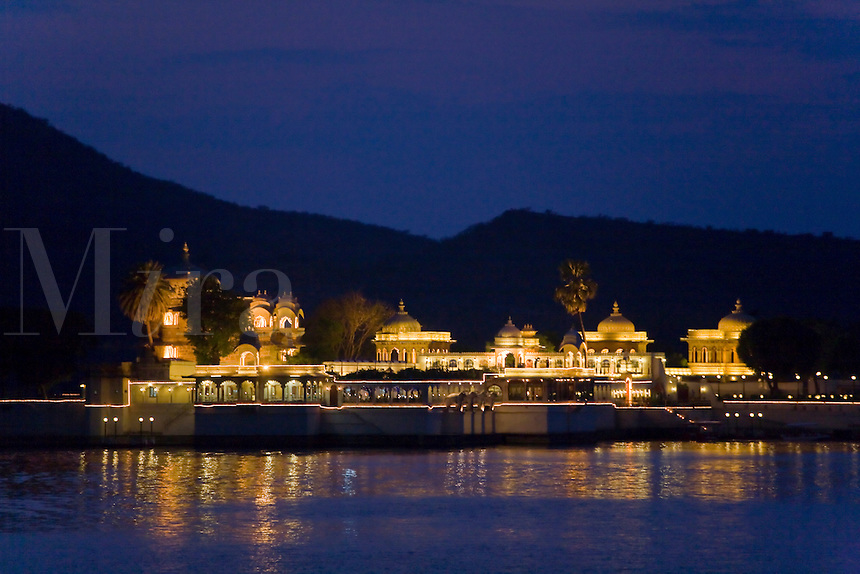 NIGHT shot of the PALACE on JAGMANDIR ISLAND on LAKE PICHOLA which was built in 1620 AD by Maharaja Karan Singh - UDAIPUR, RAJASTHAN, INDIA