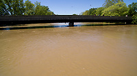 The White River flows under the The Old Ellettsville Road bridge in Spencer, Indiana on Sunday, May 7, 2017. (Photo by James Brosher)