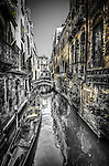 Golden, black & white image of canal in San Marco sestiere, Venice, Italy