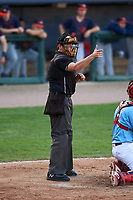 Home plate umpire Jeff Hamann calls a strike during a Midwest League game between the Peoria Chiefs and Bowling Green Hot Rods at Dozer Park on May 5, 2019 in Peoria, Illinois. Peoria defeated Bowling Green 11-3. (Zachary Lucy/Four Seam Images)