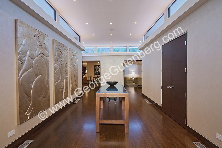 relief wall art in gallery area with clerestory windows