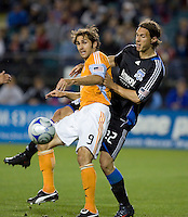 Brian Mullan (9) and Kelly Gray (22) battle for the ball. San Jose Earthquakes defeated Houston Dynamo 3-2 at Buck Shaw Stadium in Santa Clara, California on March 28th, 2009.