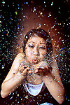 Model Irene Caguinguin has a little fun with the newest craze amoug the club kids, glitter.