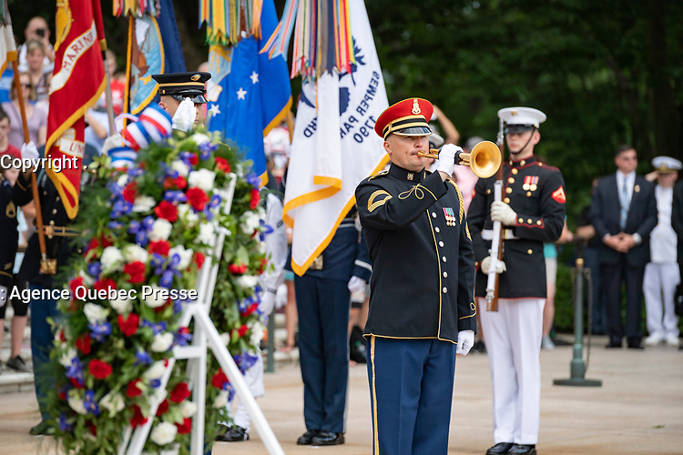 """A bugler from the U.S. Army Band, """"Pershing's Own,"""" plays """"Taps"""" as part of the Armed Forces Full Honors Wreath-Laying Ceremony in observance of Memorial Day at Arlington National Cemetery, Arlington, Virginia, May 27, 2019. This was the 151st annual Memorial Day Observation at Arlington National Cemetery. (U.S. Army photo by Elizabeth Fraser / Arlington National Cemetery / released)"""