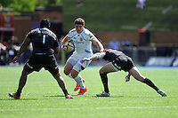 David Ewers of Exeter Chiefs is tackled by Marcelo Bosch of Saracens as Mako Vunipola of Saracens lies in wait