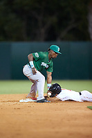 Daytona Tortugas second baseman Shed Long (4) can not come up with the throw as Ray-Patrick Didder slides head first into the base during a game against the Florida Fire Frogs on April 6, 2017 at Osceola County Stadium in Kissimmee, Florida.  Daytona defeated Florida 3-1.  (Mike Janes/Four Seam Images)