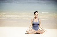 Woman in meditation at the beach