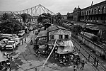 Famous Howrah Bridge is seen at a distace from a warehouse in Kolkata, India.