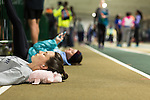 January 25, 2014. Winston Salem, North Carolina.<br /> Kayla Montgomery rests after stretching before running in the 1600m at the 2014 David Oliver Classic. <br />  3 and a half years ago, during an examination after sustaining tailbone and head injuries from a fall during a soccer game, Kayla Montgomery, now 18, was diagnosed with multiple sclerosis. Montgomery, then a decent runner, refused to be limited by her diagnosis, and after years of training has become one of the best high school runners in the country.