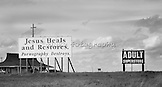 """Traveling East on Interstate 70, just west of Salina, KS.  On the other side of the highway is an adult store bordering on a farm.  The American way:  Freedom of speech, religion and the pursuit of happiness  20"""" x 11"""".  Printed on Parrot Digigraphic Ultra Lustre Photopaper.  Limited Edition of 25."""