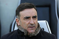 Swansea manager Carlos Carvalhal sits in the dug out area during the Premier League match between Brighton and Hove Albion and Swansea City and at the Amex Stadium, Brighton, England, UK. Saturday 24 February 2018