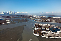 Aerial of the dusty, windy, Copper River Delta and Chugach Mountans, Alaska.