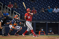Washington Nationals Kyle Schwarber (12) bats during a Major League Spring Training game against the Houston Astros on March 19, 2021 at The Ballpark of the Palm Beaches in Palm Beach, Florida.  (Mike Janes/Four Seam Images)