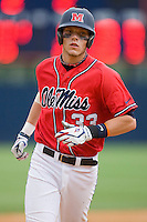 Matt Snyder #33 Ole Miss Rebels rounds the bases after hitting a grand slam in the 9th inning against the St. John's Red Storm at the Charlottesville Regional of the 2010 College World Series at Davenport Field on June 6, 2010, in Charlottesville, Virginia.  The Red Storm defeated the Rebels 20-16.  Photo by Brian Westerholt / Four Seam Images
