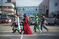 140927-JRE-7981E-0505<br /> Fans cross 5th Avenue on their way to Senshi-Con, Saturday at the Egan Center. Photo by James R. Evans