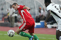 Hungary's Andras Simon (8) battles Ghana's Daniel Addo (5) during the FIFA Under 20 World Cup Semi-final match at the Cairo International Stadium in Cairo, Egypt, on October 13, 2009. Costa Rica won the match 1-2 in overtime play. Ghana won the match 3-2.