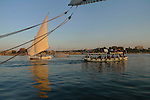 Various craft on the River Nile at Luxor.The town of Luxor occupies the eastern part of a great city of antiquity which the ancient Egytians called Waset and the Greeks named Thebes.