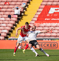 24th April 2021, Oakwell Stadium, Barnsley, Yorkshire, England; English Football League Championship Football, Barnsley FC versus Rotherham United; Michael Smith of Rotherham challenging  Mads Juel Andersen of Barnsley