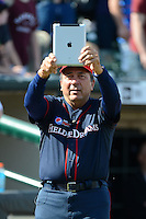 Hall of Fame catcher Johnny Bench records the crowd with his iPad before the MLB Pepsi Max Field of Dreams game on May 18, 2013 at Frontier Field in Rochester, New York.  (Mike Janes/Four Seam Images)