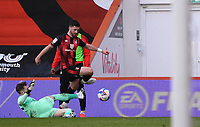 13th March 2021; Vitality Stadium, Bournemouth, Dorset, England; English Football League Championship Football, Bournemouth Athletic versus Barnsley; goalkeeper Bradley Collins of Barnsley slides in and tackles Shane Long of Bournemouth