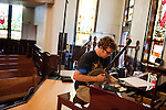 September 14, 2010.  Durham, North Carolina.. Phil Cook tunes his banjo to the piano.. Day One of Sounds of the South, a reinterpretation of Alan Lomax's field recordings, with music by Megafaun, Fight the Big Bull, Sharon Van Etten and Justin Vernon of Bon Iver..