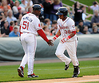 Shortstop Jose Garcia (36) of the Greenville Drive, Class A affiliate of the Boston Red Sox, is congratulated by manager Billy McMillon after hitting a home run in a game against the Augusta GreenJackets on April 7, 2011, at Fluor Field at the West End in Greenville, S.C.