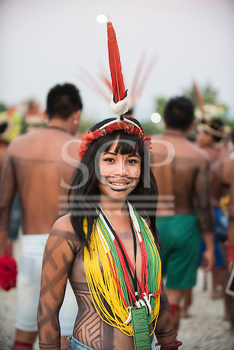 A Brazilian indigenous woman with a red macaw feather headdress siles at the first ever International Indigenous Games, in the city of Palmas, Tocantins State, Brazil. Photo © Sue Cunningham, pictures@scphotographic.com 22nd October 2015