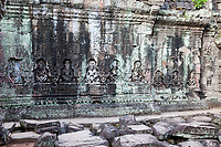 Cambodia.  Preah Khan Ruins.  Hermits in Prayer along the Side of an Interior Chapel.  12th. Century.
