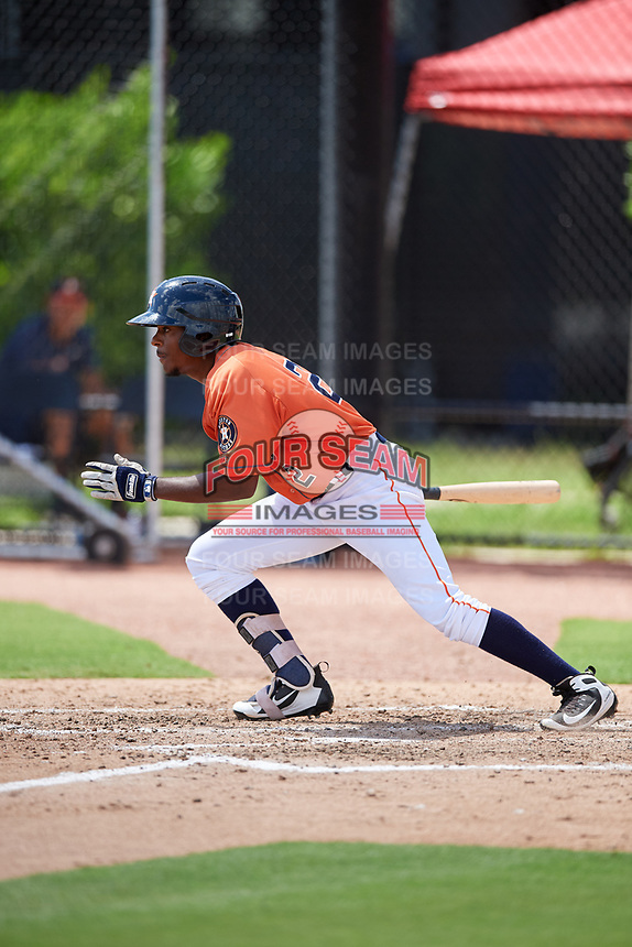 GCL Astros right fielder Juan Ramirez (2) follows through on a swing during a game against the GCL Marlins on August 5, 2018 at FITTEAM Ballpark of the Palm Beaches in West Palm Beach, Florida.  GCL Astros defeated GCL Marlins 2-1.  (Mike Janes/Four Seam Images)