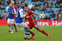 Wayne Routledge of Swansea City (R) moves forward after passing the ball a Sheffield Wednesday player (L) during The Emirates FA Cup Fifth Round match between Sheffield Wednesday and Swansea City at Hillsborough, Sheffield, England, UK. Saturday 17 February 2018