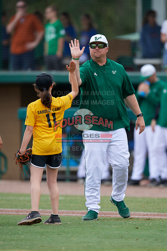 Young fan high fives head coach Billy Mohl after throwing out a ceremonial first pitch before a USF Bulls game against the Dartmouth Big Green on March 17, 2019 at USF Baseball Stadium in Tampa, Florida.  USF defeated Dartmouth 4-1.  (Mike Janes/Four Seam Images)