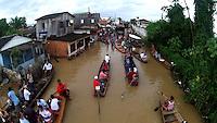 Com 18 bairros embaixo dágua e cerca de oito mil casas desocupadas, a enchente no estado do Acre, continua a causar estragos,   o rio Acre registrou hoje a cota de  16,77m   a maior registrada em 2014. As famílias estão sendo alojadas no Parque de Exposições. <br /> RIO BRANCO, Acre, Brasil.<br /> Foto Odair Leal <br /> 12/03/2014