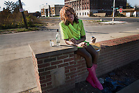 """""""Deborah"""", who works as a prostitute, getting drunk in front of a liquor store in Detroit, Michigan."""