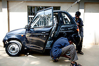 Workers makes adjustments to the Reva (G-Wiz) Electric Cars in Bangalore, India on Wednesday, 03 January 2007.