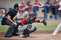 Carolina Mudcats catcher Darrien Miller (12) sets a target as home plate umpire Zee Zdenek looks on during the game against the Kannapolis Cannon Ballers at Atrium Health Ballpark on June 13, 2021 in Kannapolis, North Carolina. (Brian Westerholt/Four Seam Images)