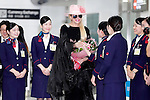 Lady Gaga receives flowers from a Japan Airlines ground staff member at Narita International Airport on November 1, 2016, Chiba, Japan. Gaga returns to Japan for the first time in two years to promote her latest album Joanne. (Photo by Rodrigo Reyes Marin/AFLO)