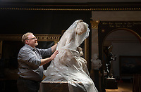 BNPS.co.uk (01202) 558833<br /> Pic: ZacharyCulpin/BNPS<br /> <br /> Art uncovered<br /> <br /> Curator, Duncan Walker removes one of the dust sheets from sculpture'The Messenger' (The Girl with Carrier Pigeon) by Lawrence MacDonald <br /> <br /> Staff at the Russell-Cotes Art Gallery & Museum in Bournemouth prepare for reopening next week after the Coronavirus pandemic lockdown.<br /> <br /> In 1907 husband and wife Merton and Annie Russell-Cotes donated East Cliff Hall and its contents including a fine art collection as a museum to the town of Bournemouth.  The couple travelled extensively visiting Australasia, America, India, the Near East, Egypt, the Pacific Islands and Japan, collecting artwork and souvenirs. <br /> After they died the Borough of Bournemouth managed East Cliff Hall before it opened as the Russell-Cotes Art Gallery and Museum in 1922.