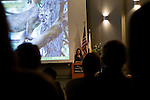 North American Cougar (Puma concolor couguar) biologists, Zara McDonald, giving presentation to increase public education about pumas, Berkeley, Bay Area, California