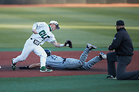 Carson Johnson (2) of the Charlotte 49ers receives a throw as Thomas Wheeler (27) of the Old Dominion Monarchs slides into second base at Hayes Stadium on April 23, 2021 in Charlotte, North Carolina. (Brian Westerholt/Four Seam Images)
