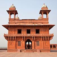 Fatehpur Sikri, Uttar Pradesh, India.  Diwan-i-Khas (Hall of Private Audience) of Emperor Jalal el-Din Akbar.  Chhatris on Corners of Roof.