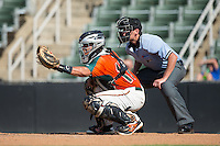 Greensboro Grasshoppers catcher Roy Morales (17) reaches for a pitch as home plate umpire Anthony Perez looks on during the game against the Kannapolis Intimidators at Intimidators Stadium on July 17, 2016 in Greensboro, North Carolina.  The Intimidators defeated the Grasshoppers 3-2 in game one of a double-header.  (Brian Westerholt/Four Seam Images)