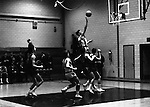 Bethel Park PA:  Scott Streiner shooting a layup against the Mt Lebanon Blue Devils at Bethel Park Gymnasium. Others in the photo; Mike Stewart. The JV Team was coached by Mr. Reno and the Bethel Park JVs won the Section Championship.  The team included; Scott Streiner, Steve Zemba, John Klein, Mike Stewart, Bruce Evanovich, Jeff Blosel, and Tim Sullivan.