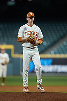 Texas Longhorns relief pitcher Mason Bryant (58) looks to his catcher for the sign against the Missouri Tigers in game eight of the 2020 Shriners Hospitals for Children College Classic at Minute Maid Park on March 1, 2020 in Houston, Texas. The Tigers defeated the Longhorns 9-8. (Brian Westerholt/Four Seam Images)