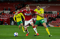 Middlesbrough's George Saville shields the ball from Norwich City's Ben Gibson<br /> <br /> Photographer Alex Dodd/CameraSport<br /> <br /> The EFL Sky Bet Championship - Middlesbrough v Norwich City - Saturday 21st November 2020 - Riverside Stadium - Middlesbrough<br /> <br /> World Copyright © 2020 CameraSport. All rights reserved. 43 Linden Ave. Countesthorpe. Leicester. England. LE8 5PG - Tel: +44 (0) 116 277 4147 - admin@camerasport.com - www.camerasport.com